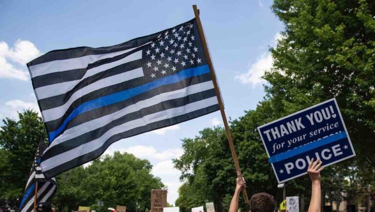 Teacher ordered to take down 'political' Thin Blue Line flag honoring her brother, a former cop — but Black Lives Matter, LGBTQ symbols are just fine